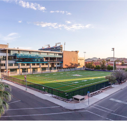 A photo of the corner of 4th Street and Vine on the UA Main Campus looking towards the Lowell-Stevens Football Facility