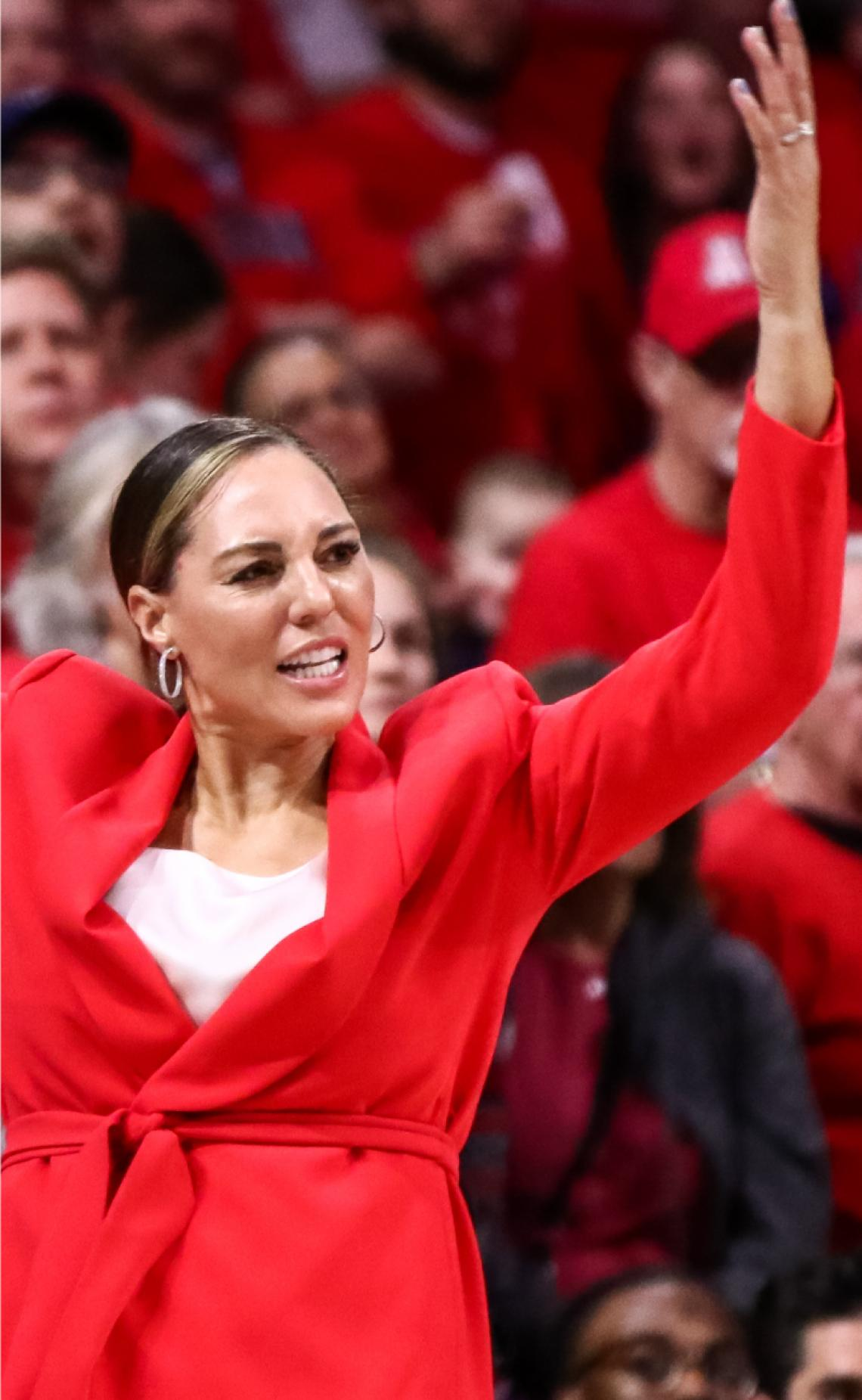 Women's Basketball Coach Adia Barnes and she challenges a call during a game, her hands are held up in protest